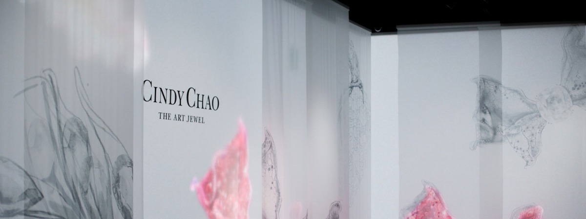Exposition design with backlit muslin canvas walls and transparent sheers